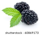 Ripe fresh blackberry with leaves - stock photo