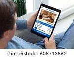 man in jeans holding tablet... | Shutterstock . vector #608713862