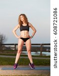 Small photo of view of beautiful woman showing abdominal muscles