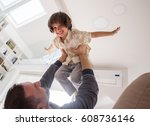 little son playing with father... | Shutterstock . vector #608736146