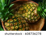 two pineapples in a wicker basket