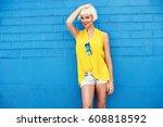 beautiful young woman walking...   Shutterstock . vector #608818592