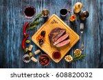 sliced medium rare grilled... | Shutterstock . vector #608820032