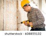 foreman wearing helmet drilling ... | Shutterstock . vector #608855132