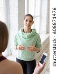 yoga coach consulting student | Shutterstock . vector #608871476