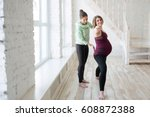 yoga trainer assisting pregnant ... | Shutterstock . vector #608872388