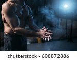 male athlete rubs hands with... | Shutterstock . vector #608872886