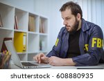 fbi agent working in his office ... | Shutterstock . vector #608880935