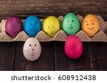 colorful easter eggs on wooden... | Shutterstock . vector #608912438