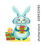 rabbit holds a gift in the paws. | Shutterstock .eps vector #608932985