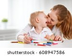 mother with the baby son with... | Shutterstock . vector #608947586