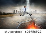 businessman trying to overcome... | Shutterstock . vector #608956922