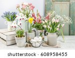 Spring Flowers On Wooden Table.