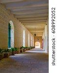 cloistered passageway down to... | Shutterstock . vector #608992052