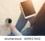 woman on the floor with tablet | Shutterstock . vector #609017642