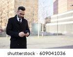 confident mature businessman... | Shutterstock . vector #609041036