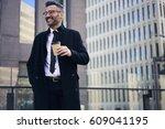 attractive prosperous mature... | Shutterstock . vector #609041195