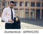 successful mature business man... | Shutterstock . vector #609041252