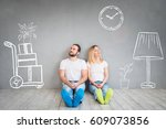 happy couple sitting on wooden... | Shutterstock . vector #609073856