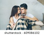 a couple in love sits on a... | Shutterstock . vector #609086102