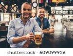 handsome guys are drinking beer ... | Shutterstock . vector #609099926
