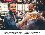 handsome guys are clinking... | Shutterstock . vector #609099956