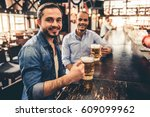 handsome guys are drinking beer ... | Shutterstock . vector #609099962