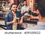 handsome guys are drinking beer ... | Shutterstock . vector #609100022