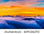 hawaii sunrise over the clouds | Shutterstock . vector #609106292