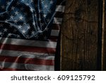 usa flag on a wood surface | Shutterstock . vector #609125792