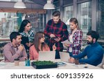 young colleagues discussing... | Shutterstock . vector #609135926