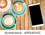 top view hot coffee in cup and... | Shutterstock . vector #609160142