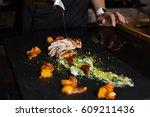 chef preparing steak dish | Shutterstock . vector #609211436