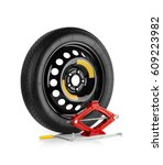 spare wheel and car jack on... | Shutterstock . vector #609223982