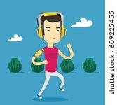 happy asian man running with... | Shutterstock .eps vector #609225455