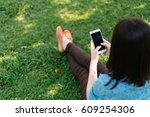 beautiful woman using her... | Shutterstock . vector #609254306