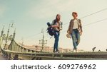 two young girlfriends traveling ... | Shutterstock . vector #609276962