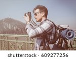 young man traveling with... | Shutterstock . vector #609277256