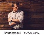 handsome man wearing checkered... | Shutterstock . vector #609288842