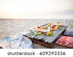 picnic on the beach at sunset... | Shutterstock . vector #609293336