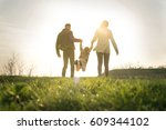 happy parents playing with... | Shutterstock . vector #609344102