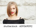 portrait of a young blonde... | Shutterstock . vector #609369092