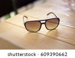 men's sunglasses at the wooden... | Shutterstock . vector #609390662