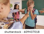 boy is bullying by children at... | Shutterstock . vector #609437018