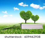 book with trees in the shape of ... | Shutterstock . vector #609462938