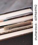 folded banknotes hidden in books | Shutterstock . vector #609464942