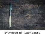 rustic fork on old wooden... | Shutterstock . vector #609485558