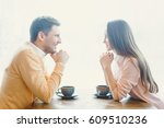 beautiful couple in cafe | Shutterstock . vector #609510236