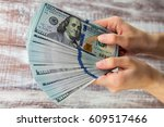 many dollars falling on woman's ... | Shutterstock . vector #609517466