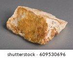 Small photo of Mineral stone corundum. Corundum is a crystalline form of aluminium oxide containing iron, titanium, vanadium and chromium.